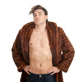 Young man in a fur coat Stock Photo