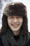 Young Man in Fur Hat Royalty Free Stock Images