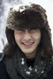 Young Man in Fur Hat with Eyes Closed, Snowball fight Royalty Free Stock Photo