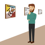 Young man in gallery room looking at abstract paintings Stock Photography