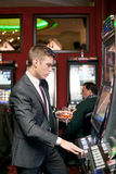 Young man gambling Royalty Free Stock Photos