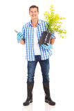 Young man gardening Royalty Free Stock Image