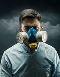 Young man in gas-mask Royalty Free Stock Photography