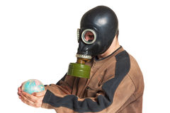 Young man in a gas mask holding a globe Royalty Free Stock Photos