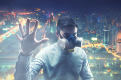 Young man in gas-mask Stock Photography
