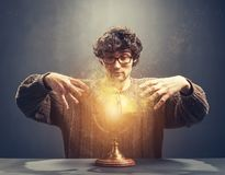 Young man gazing at the glowing crystal ball. stock images
