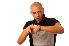 Young man gesture being late watching on watch isolated over whi Stock Images
