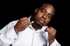 Young man gesturing. A young black man making hand gestures Stock Image