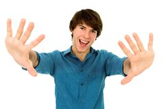 Young man gesturing. And smiling Stock Image