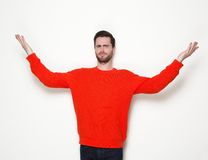 Young man gesturing with arms raised Royalty Free Stock Images