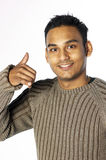 Young man gesturing call me Stock Photo