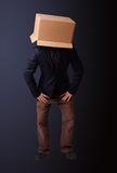 Young man gesturing with a cardboard box on his head Royalty Free Stock Photo