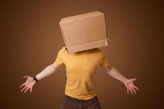 Young man gesturing with a cardboard box on his head Stock Photography