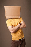 Young man gesturing with a cardboard box on his head Royalty Free Stock Images