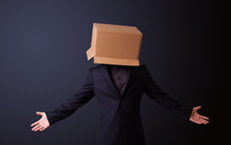 Young man gesturing with a cardboard box on his head Royalty Free Stock Photography