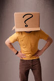 Young man gesturing with a cardboard box on his head Stock Photos