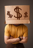 Young man gesturing with a cardboard box Royalty Free Stock Images