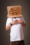 Young man gesturing with a cardboard box Stock Images