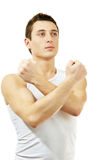 Young man gesturing fight symbol. Isolated on whit Royalty Free Stock Images