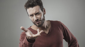 Young man gesturing Royalty Free Stock Photography