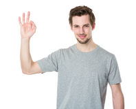 Young man gesturing okay sign Stock Photography