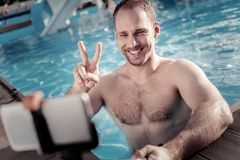 Young man gesturing while posing for self portrait picture royalty free stock photo