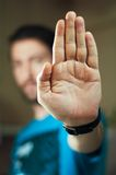Young man gesturing stop with his hand. Young man with blue teeshirt gesturing stop with his hand Stock Photo