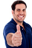 Young man gesturing thumbs up Stock Photography
