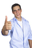 Young man gesturing thumbs up Stock Image
