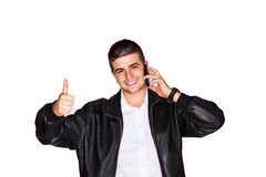 Young man gesturing thumbs-up Royalty Free Stock Images