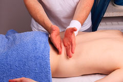 Young man gets back massage Royalty Free Stock Photos