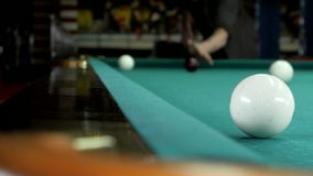 The young man gets into a billiard pocket stock footage