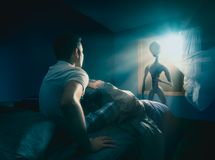 Young man getting abducted stock photography