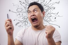 Free Young Man Getting Bad News On Phone, Shocked And Angry Royalty Free Stock Photo - 156231305