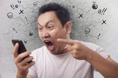 Free Young Man Getting Bad News On Phone, Shocked And Angry Royalty Free Stock Photography - 157862137