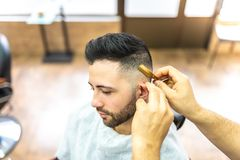 Young Man Getting a Beard Shaved stock photos
