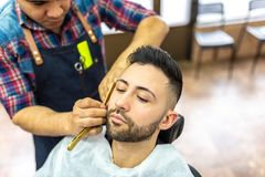 Young Man Getting a Beard Shaved royalty free stock photography
