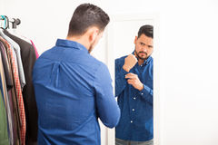 Young man getting dressed and looking good Royalty Free Stock Photography