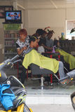 Young man getting haircut Royalty Free Stock Photos