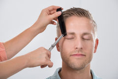 Young Man Getting His Eyebrow Trimmed Royalty Free Stock Photo