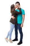 Young man getting a kiss from girlfriend stock images