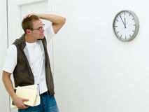 Young man getting late Stock Photo