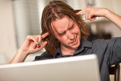 Young Man Getting Loopy While Using Laptop Royalty Free Stock Photos