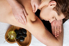 Young man getting massage Royalty Free Stock Images