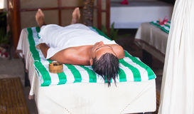 Young man getting massage lying down during summer Stock Photography