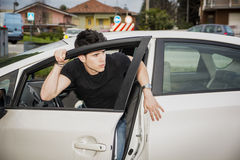 Young man getting out of white car Royalty Free Stock Photo