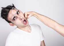 Young man getting punched in the jaw. Royalty Free Stock Images