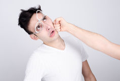 Young man getting punched in the jaw. Royalty Free Stock Photography