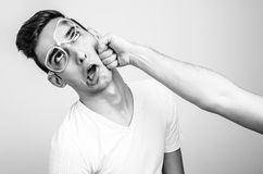 Young man getting punched in the jaw. Royalty Free Stock Photos