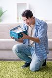 The young man getting rabbit as birthday present. Young man getting rabbit as birthday present Royalty Free Stock Images
